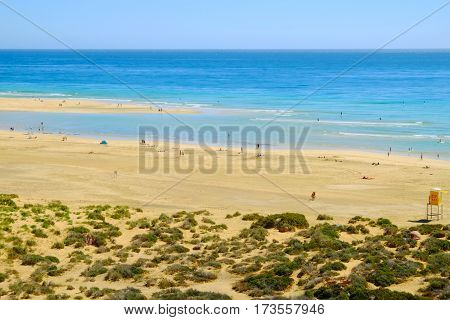 Aerial view on the beach Playa de Sotavento with unknown people. Fuerteventura Spain - 16.02.2017.