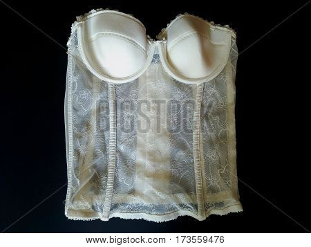 Beautiful white corset for women isolated on black background