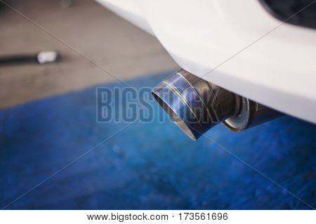Close up of a car exhaust titanium pipe.