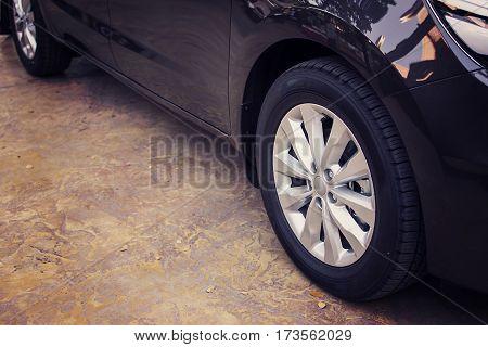 Alloy wheel of luxury car in view side.
