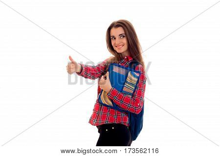 smiling young girl in shirt hand class and keeps the folder with notebooks is isolated on a white background