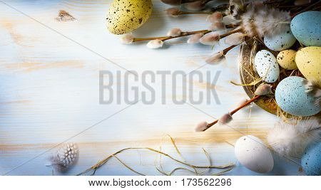 Easter background with Easter eggs and spring flowers. Top view with copy space