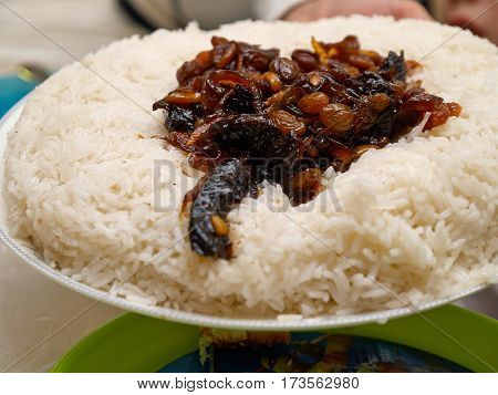 Traditional Arabic Middle East dish cooked rice with fried onions and raisins