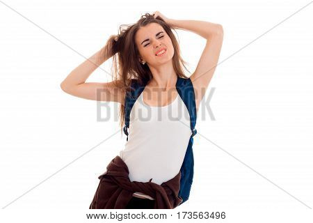 a young girl in a white t-shirt with a backpack on your back closed her eyes and keeps hands hair viciously isolated on white background. poster