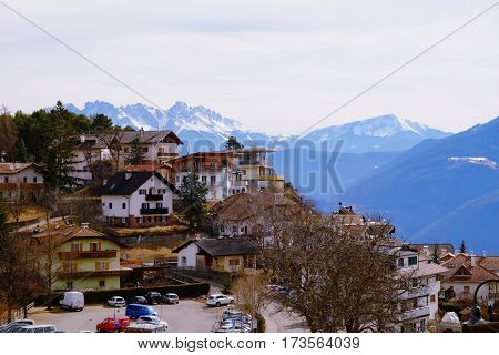 Village Jenesien with mountains Dolomites on the background. South Tyrol Italy - 26.02.2017.