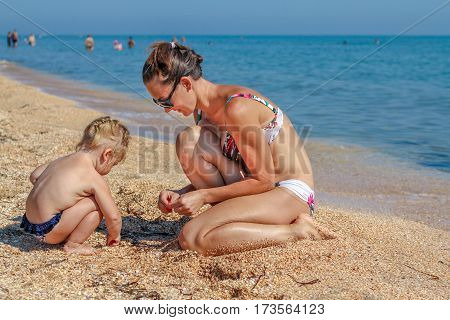 Little Baby Girl With Mother On Beach