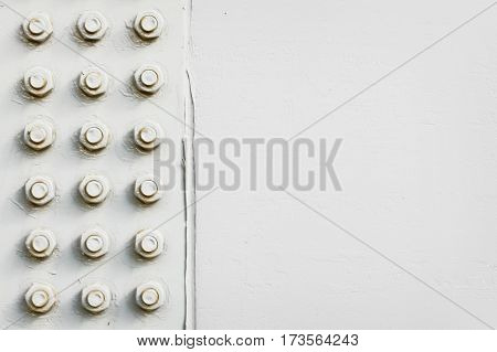 Detail of a steel structure with bolts painted in grey