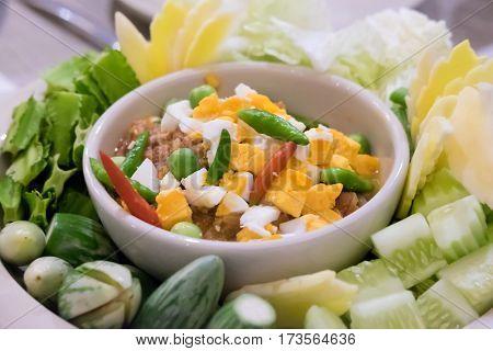 Naam Prik Long Rau chilli dip with pork and egg yolk Thai cuisine