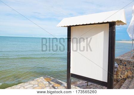 Billboard on the beach near the sea