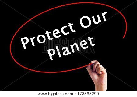 Hand Writing Protect Our Planet With A Marker Over Transparent Board