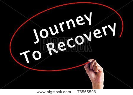 Hand Writing Journey To Recovery With A Marker Over Transparent Board