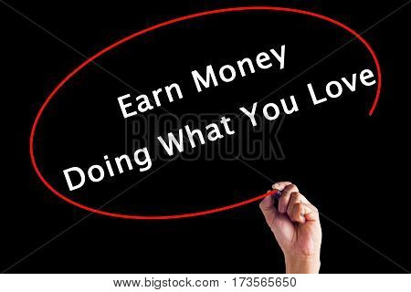 Hand Writing Earn Money Doing What You Love With A Marker Over Transparent Board