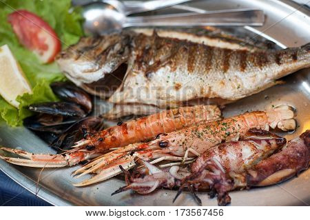 Hearty plate of various grilled seafood in Dubrovnic restaurant, Croatia