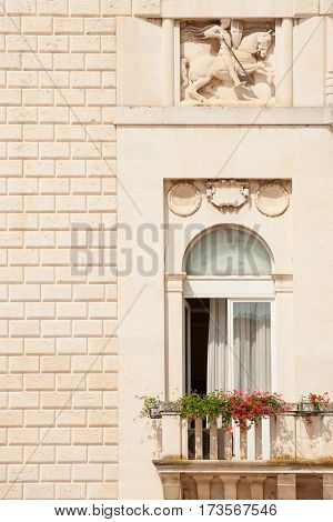 Beautiful window and balcony of old building in Zadar historic center, Croatia