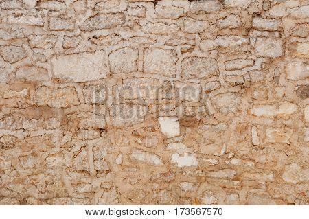 Masonry background of old Zadar stone building, Croatia
