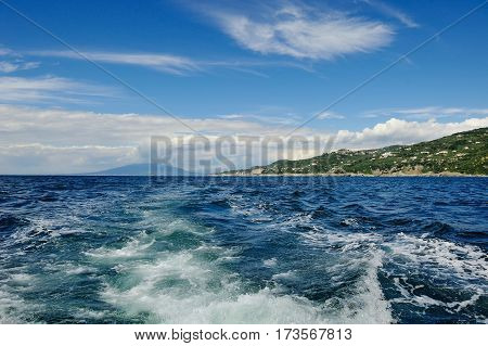 Blue sea and sky in a summer day near Sorrento on background Vesuvius
