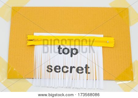 Top Secret destroying sheet of paper with yellow zipper as a shredder