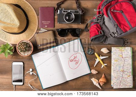 Travel plan trip vacation accessories for trip tourism mockup - Outfit of traveler on wooden background. Flat lay.