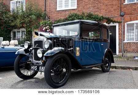 AMERSHAM, UK - SEPTEMBER 13: A vintage Austin 7 motorcar is parked on the side of the highway as a static display at the Amersham Heritage Day festival on September 13, 2015 in Amersham.