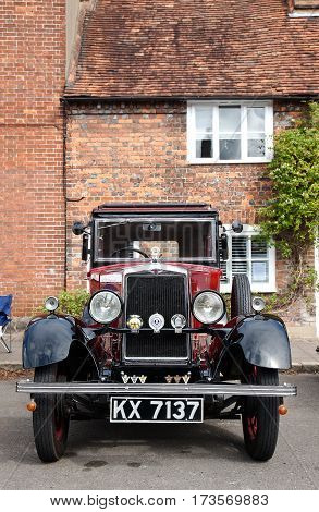 AMERSHAM, UK - SEPTEMBER 13: A vintage Morris motorcar is parked on the side of the highway as a static display at the Amersham Heritage Day festival on September 13, 2015 in Amersham.