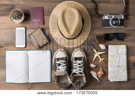 Travel plan trip vacation tourism mockup - Outfit of traveler on wooden background. Flat lay.