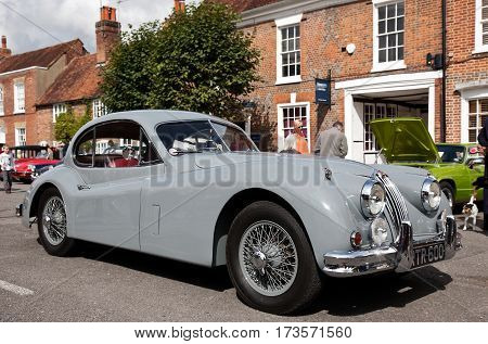 AMERSHAM, UK - SEPTEMBER 13: A vintage Jaguar sportscar is parked on the side of the highway as a static display at the Amersham Heritage Day festival on September 13, 2015 in Amersham.