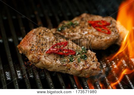 pork steak meat on bbq grill , home made
