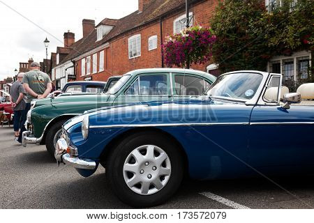 AMERSHAM, UK - SEPTEMBER 13: A vintage MG classic sportscar is parked on the side of the highway as a static display at the Amersham Heritage Day festival on September 13, 2015 in Amersham.