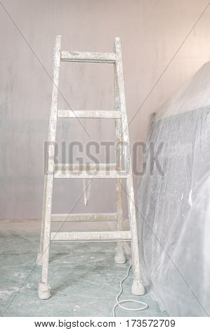 Renovation Of A Wall In Empty Room With Ladder