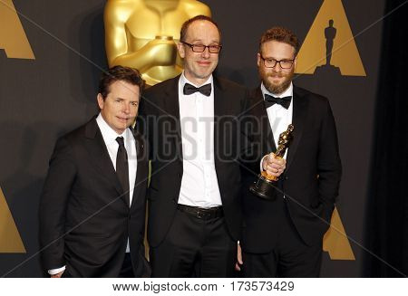 John Gilbert, Seth Rogen and Michael J. Fox at the 89th Annual Academy Awards - Press Room held at the Hollywood and Highland Center in Hollywood, USA on February 26, 2017.