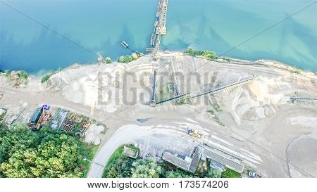 Aerial view of a gravel quarry with beautiful blue lake