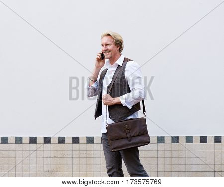 Business Man Walking And Talking On Cellphone