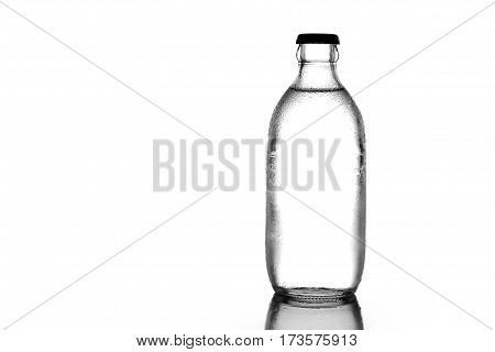 Bottle glass of soda or water on white background