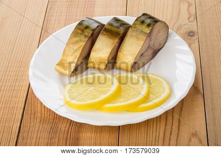 Pieces Of Mackerel And Slices Of Lemon In Plate