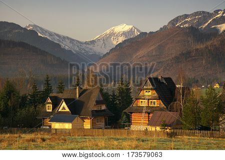 Scenic View Of A Wonderful Valley In The Mountains With Wooden Rural Farm House Buildings