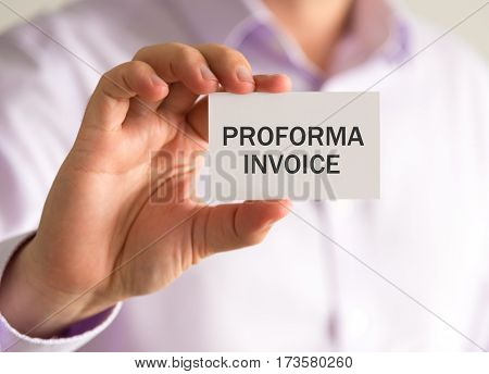 Businessman Holding A Card With Proforma Invoice Message