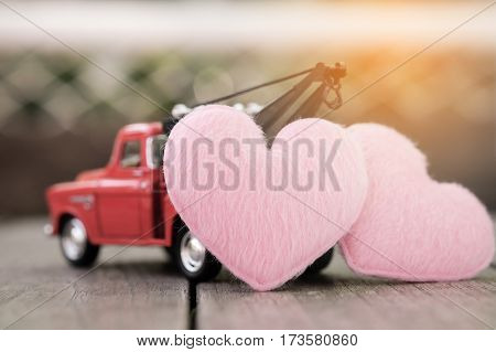 Small red toy car and pink hearts for valentine's Day Vintage Tone