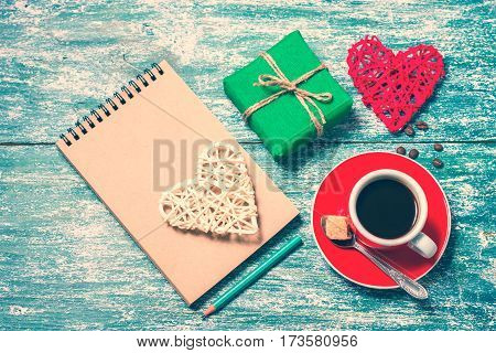 Notepad, Cup Of Coffee, Box With Gift On A Blue Wooden Table. Space For Text