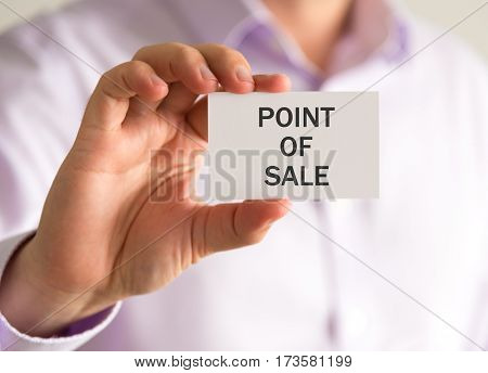 Businessman Holding A Card With Point Of Sale Message