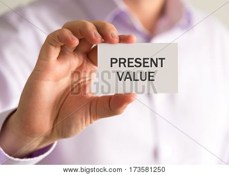 Businessman Holding A Card With Present Value Message