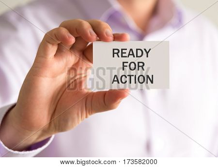 Businessman Holding A Card With Ready For Action Message