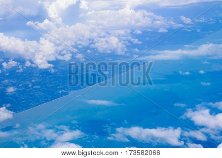 Abstract background of beautiful blue sky with clouds over land and sea