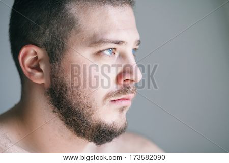Young man with a problem looking away
