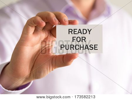 Businessman Holding A Card With Ready For Purchase Message