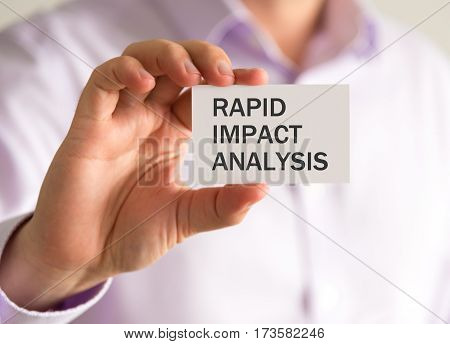 Businessman Holding A Card With Rapid Impact Analysis Message