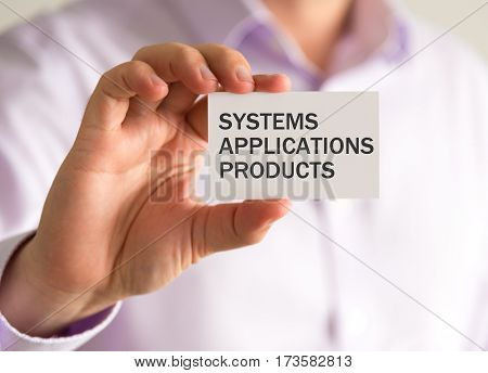 Businessman Holding A Card With Systems Applications Products Message