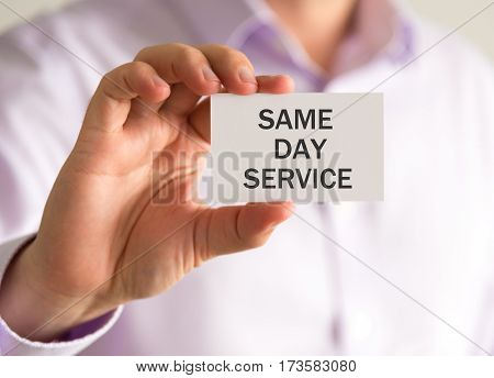 Businessman Holding A Card With Same Day Service Message