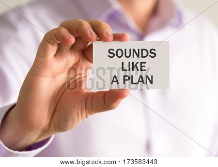 Businessman Holding A Card With Sounds Like A Plan Message
