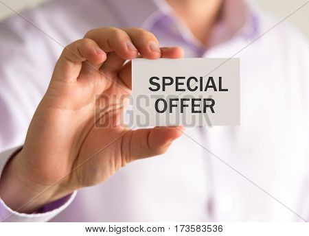 Businessman Holding A Card With Special Offer Message