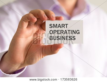 Businessman Holding A Card With Smart Operating Business Message